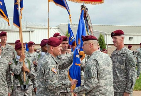 Col. John R. Evans (left) accepts the 160th Special Operations Aviation Regiment Colors from Col. Clayton M. Hutmacher, U.S. Army Special Operations Aviation Command Commanding General, as he assumed command from Col. John W. Thompson during a ceremony at Fort Campbell, KY, on Friday. (U.S. Army Photo)