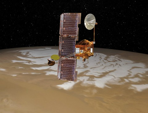 NASA's Mars Odyssey spacecraft passes above Mars' south pole in this artist's concept illustration. The spacecraft has been orbiting Mars since October 24th, 2001. (Image credit: NASA/JPL)