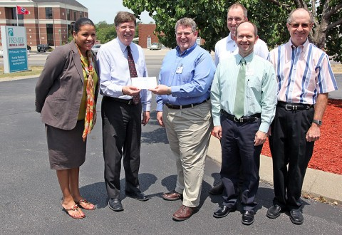 CMCSS Director of Schools Mike Harris, and Foundation Director Candy Johnson accept an $11,000 sponsorship gift from Premier physicians (from left) Dr. Michael Engel, Dr. Joe Kosinski, Dr. Lance Sherley, and Dr. Mike Carrigan.