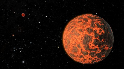 This artist's concept shows what astronomers believe is an alien world just two-thirds the size of Earth -- one of the smallest on record. It was identified by NASA's Spitzer Space Telescope. The exoplanet candidate, known as UCF-1.01, orbits a star called GJ 436, which is located a mere 33 light-years away. UCF-1.01 might be the nearest world to our solar system that is smaller than our home planet. (Image credit: NASA/JPL-Caltech)