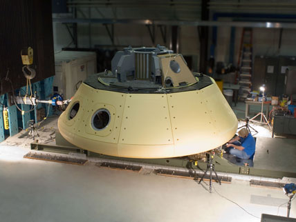 Preparations underway for the CPAS Parachute Test Vehicle load test performed in 2008. (Credit: NASA)