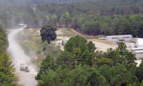 Soldiers from 1st Brigade Combat Team, 101st Airborne Division, drive their convoy into Forward Operating Base Spirit July 1st at the Joint Readiness Training Center here. (Photo by Sgt. Jon Heinrich)