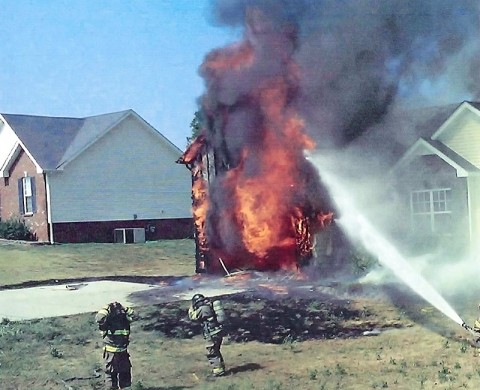 Clarksville Fire Rescue firefighters putting out an arson fire at 3650 Oakland Road.