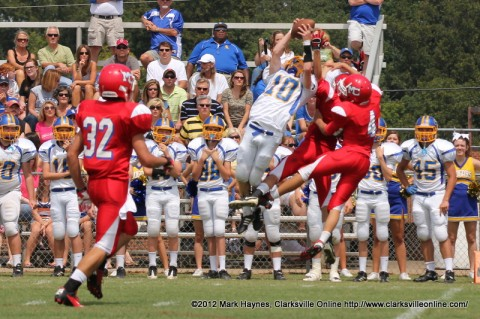 Clarksville Academy's #10 Clay Goad goes up to catch a pass amongst two Montgomery Central defenders Saturday afternoon.
