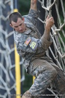 A soldier climbs down the Tough One Obstacle