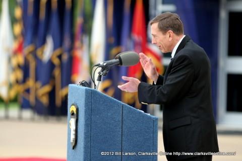 Gen. David H. Petraeus (U.S. Army Ret) applauds Command Sergeant Major Marvin L. Hill  at his retirement ceremony