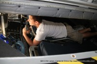 A young man tries out the refueling seat in a KC-135 Tanker