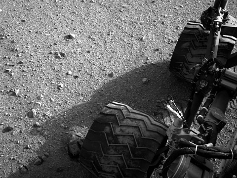Soil clinging to the right middle and rear wheels of NASA's Mars rover Curiosity can be seen in this image taken by the Curiosity's Navigation Camera after the rover's third drive on Mars. (Image credit: NASA/JPL-Caltech)