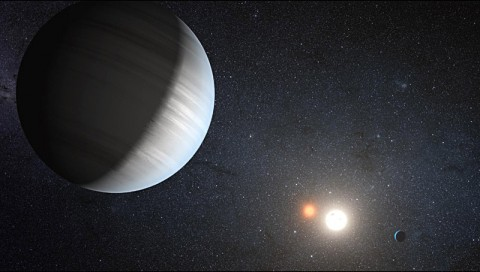 Sharing the Light of Two Suns: This artist's concept illustrates Kepler-47, the first transiting circumbinary system. (Credit: NASA/JPL-Caltech/T. Pyle)