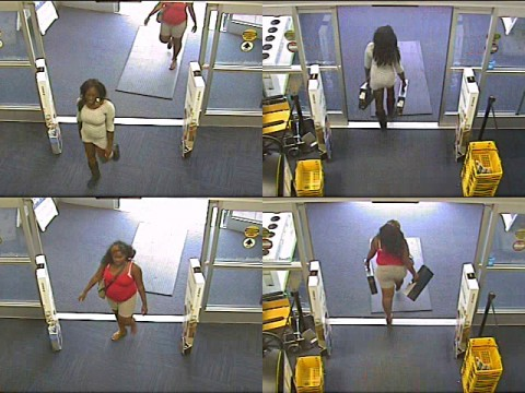 Suspects entering the store and then leaving with the laptops.