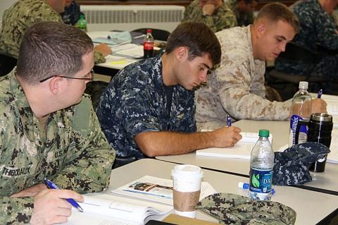 Navy Petty Officer 2nd Class Dusty Thibodaux, Navy Petty Officer 2nd Class Kasey Schmidt and Marine Corps Sgt. Joshua Johnston attend a Transition GPS pilot program resume class at Naval Station Norfolk, Va., Aug. 15, 2012. (Terri Moon Cronk/U.S. DOD)