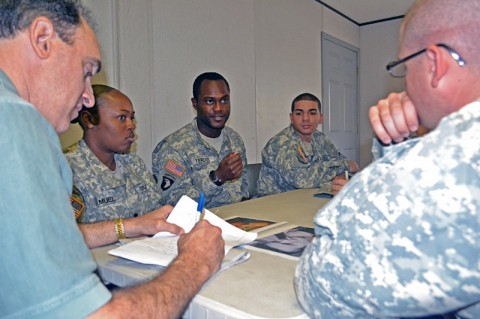 Spc. Patrick Tercius (center), a help desk specialist with Headquarters and Headquarters Company, 159th Combat Aviation Brigade, shares his perceptions of an image displayed during a Stigma Reduction Communications Campaign workshop Tuesday at Fort Campbell, Ky. The SRCC's goal is to produce an over-arching message to address Soldiers with serious personal issues that perceived stigmas are not a barrier to seek help. (Photo by Jennifer Andersson)