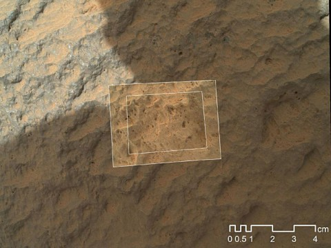 This image combines photographs taken by the Mars Hand Lens Imager (MAHLI) at three different distances from the first Martian rock that NASA's Curiosity rover touched with its arm. (Image credit: NASA/JPL-Caltech/MSSS )