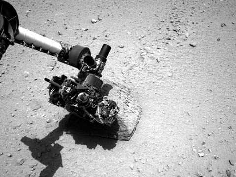 This image shows the robotic arm of NASA's Mars rover Curiosity with the first rock touched by an instrument on the arm. (Image credit: NASA/JPL-Caltech)
