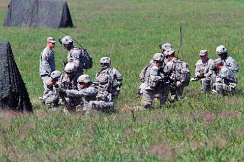 Soldiers from 2nd Battalion, 506th Infantry Regiment and 4th Battalion, 320th Field Artillery Regiment, 4th Brigade Combat Team, 101st Airborne Division, conduct walk-and-shoot rehearsals on Son Drop Zone, Aug. 28, 2012 at Fort Campbell, Ky. The walk-and-shoot rehearsals are designed to provide an additional iteration for company, battery, and troop leadership with an opportunity to exercise and refine their capability to call for fire and request close combat aircraft prior to a live fire exercise. (U.S. Army photo by Staff Sgt. Todd A. Christopherson, 4th Brigade Combat Team Public Affairs)