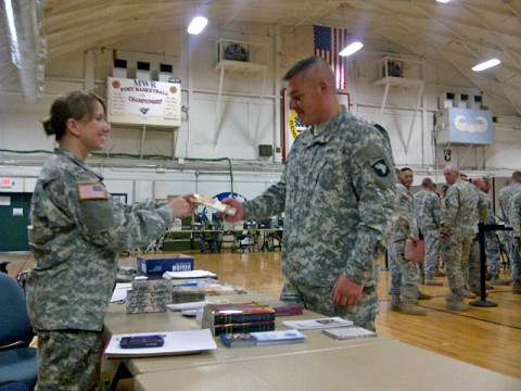 U.S. Army Capt. Delana I. Small, chaplain with Headquarters and Headquarters Company, 4th Battalion, 320th Field Artillery Regiment, 4th Brigade Combat Team, 101st Airborne Division, and a native of Springfield, MS, greets and shares literature with a soldier as part of her religious support duties at Fort Campbell, Ky. Small was assigned as the 101st Airborne Division's first female chaplain in a combat arms unit as part of the Department of Defense initiative, Women in the Service Review.