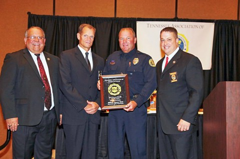 (L to R) Ret Chief Joe Garner-Past TACP President, Chief Al Ansley, Officer James Eure, and Chief Brad Lindsey, DYER PD, Award Committee Chairman. (Photo by Major Clyde Atkison, Murfreesboro PD)