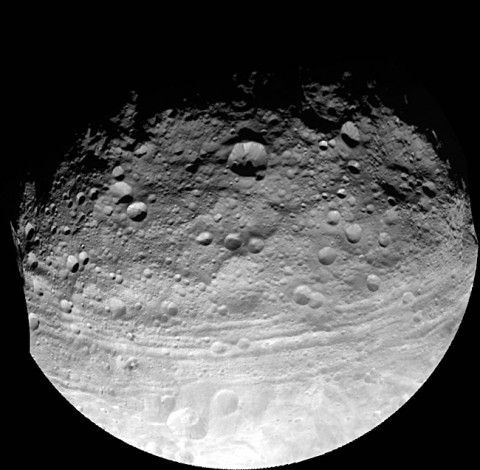 This full view of the giant asteroid Vesta was taken by NASA's Dawn spacecraft, as part of a rotation characterization sequence on July 24, 2011, at a distance of 3,200 miles (5,200 kilometers). A rotation characterization sequence helps the scientists and engineers by giving an initial overview of the character of the surface as Vesta rotated underneath the spacecraft. (Image credit: NASA/JPL-Caltech/UCLA/MPS/DLR/IDA)