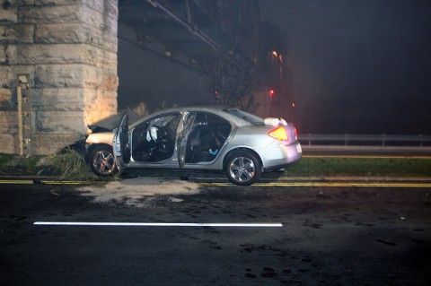 Pontiac G-6 runs into rail road bridge abutment near Crossland Avenue. (Photo by Officer Bill Van Beber-CPD)