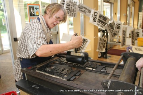 Cynthia Marsh inking the Goldsmith press at the APSU Library on 9/11