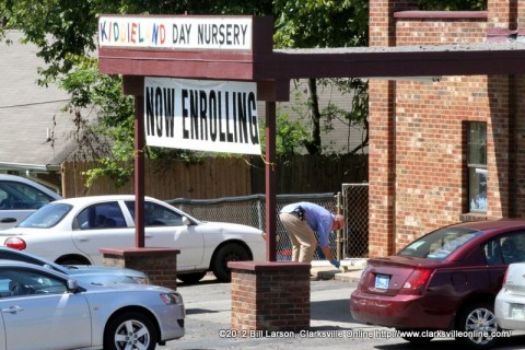 Clarksville Police Department Detective Dave Bramel gathers evidence at Kiddieland Day Nursery on Chapel Street after the shooting.
