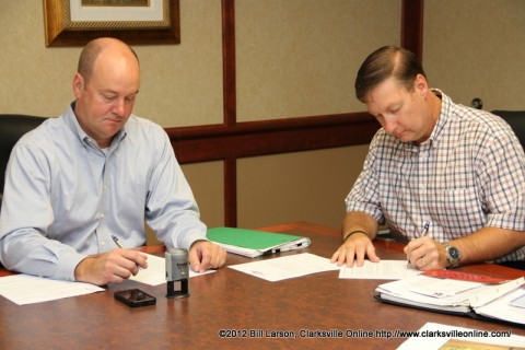 Montgomery County Attorney Austin Peay VII  and J. Lee Powell sign the paperwork transferring ownership of the property on September 7th, 2012