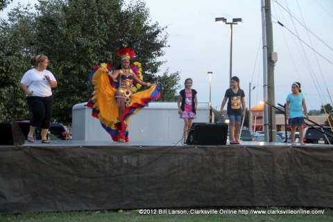 Ballet Folklorico Viva Panama's Carnival Queen Shanida Hatcher demonstrating the Salsa to the crowd on the River of Culture Stage