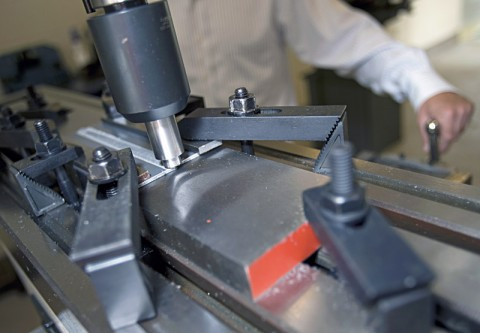 """Dr. William """"Russ"""" Longhurst demonstrates friction stir welding on a milling machine in the APSU Hemlock Semiconductor Building. (Photo by Beth Liggett/APSU staff)"""