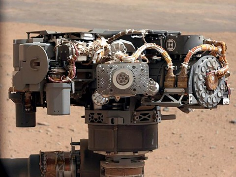 This image shows the Alpha Particle X-Ray Spectrometer (APXS) on NASA's Curiosity rover, with the Martian landscape in the background. (Image credit: NASA/JPL-Caltech/MSSS)