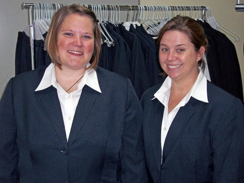 (L-R) Sabrina Wallace and Anna Collins posed showing off the suits they tried on when getting fitted for their very own new suits. (Photo by Lois Jones)