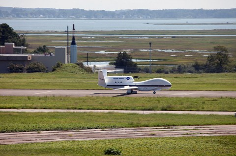 An unmanned NASA Global Hawk aircraft comes in for a landing at NASA's Wallops Flight Facility on Wallops Island, VA, Sept. 7, kicking off the month-long Hurricane and Severe Storm Sentinel (HS3) mission. HS3 will help researchers and forecasters uncover information about how hurricances and tropical storms form and intensify. (Image credit: NASA)