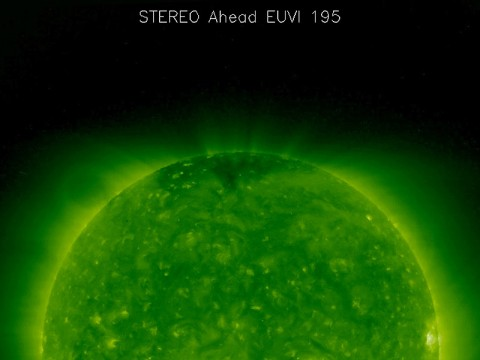 The faint oval hovering above the upper left limb of the sun in this picture is known as a coronal cavity. NASA's Solar and Terrestrial Relations Observatory (STEREO) captured this image on Aug. 9th, 2007. A team of scientists extensively studied this particular cavity in order to understand more about the structure and magnetic fields in the sun's atmosphere. (Credit: NASA/STEREO)