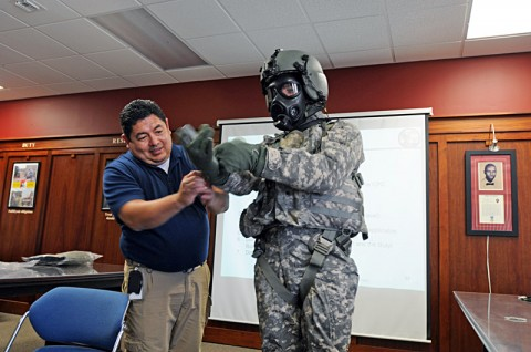 Bobbie Salazar, a Personal Protective Equipment Team member, helps Chief Warrant Officer 2 Nathan Smith, a pilot with Troop A, 7th Squadron, 17th Cavalry Regiment, 159th Combat Aviation Brigade, don the Joint Protective Aircrew Ensemble, designed specifically for aviators. The 159th CAB is the first stateside Army unit to field the JPACE. (Photo by Capt. Xeriqua Garfinkel)