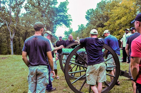 Officers and senior enlisted with 1st Battalion, 502nd Infantry Regiment, 2nd Brigade Combat Team, 101st Airborne Division (Air Assault), gather around a cannon used during the civil war by the confederates defending Fort Donelson, September 28th. The cannons were used with other defense techniques to keep the encroaching Union soldiers at bay.