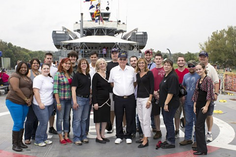 APSU faculty and history students stand on the deck of the World War II vessel the LST 325 with the ship's captain, Robert D. Jornlin. (Photo by Charles Booth/APSU Staff).