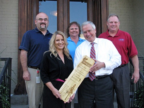 Four Star Benefactor Award for Cumberland Bank and Trust's sponsorship of the Queen City Road Race being presented.