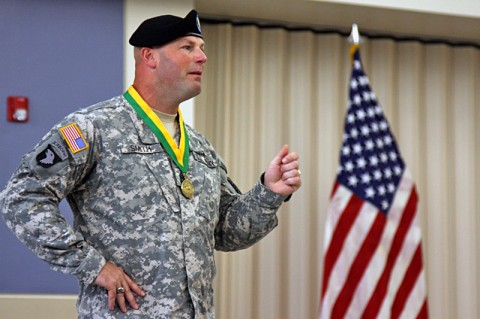 Command Sgt. Maj. James C. Smith wears his newly awarded Order of Marechaussee while he speaks to wounded, injured and ill Soldiers about overcoming obstacles Sept. 28th during a Fort Campbell Warrior Transition Battalion award ceremony. During Smith's four years of active duty service in the Army, 20 years of service with the Tennessee Army National Guard and 19 years with the Clarksville Police Department, he has exhibited outstanding professional competence in the Military Police Regiment.