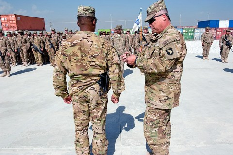 U.S. Army Command Sgt. Maj. Marion E. Arnett, command sergeant major Task Force Troubleshooter, places a Screaming Eagle patch on the right shoulder of Lt. Col. Benjamin S. Bahoque, commander TF Troubleshooter, during a combat patch ceremony on Bagram Airfield, Afghanistan on Sept. 22, 2012. (U.S. Army photo by Sgt. Duncan Brennan, 101st CAB PAO)