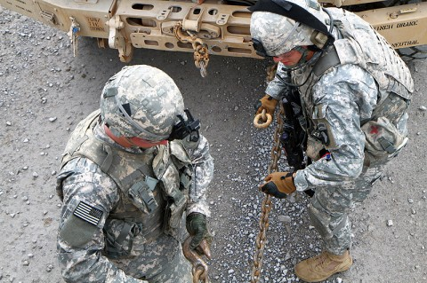 Soldiers from 4th Brigade Special Troops Battalion, 4th Brigade Combat Team, 101st Airborne Division, conduct a hasty recovery on a disabled vehicle during a convoy live-fire exercise, Oct. 13th, 2012, as part of the brigade's field exercise, Eagle Flight III at Fort Campbell, KY. (Photo by Staff Sgt. Todd Christopherson)