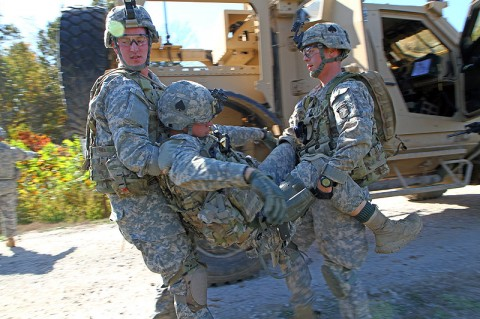 Soldiers with Headquarters and Headquarters company, 4th Brigade Combat Team, 101st Airborne Division, carry a simulated casualty from a vehicle that had disabled by an improvised explosive device during a convoy live-fire training exercise, Oct. 15th, 2012, during the brigade's field exercise Eagle Flight III, at Fort Campbell, KY. (Photo by Staff Sgt. Todd Christopherson)