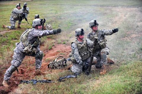 A 60mm mortar system mortar crew with Company D, 2nd Battalion, 506th Infantry Regiment, 4th Brigade Combat Team, 101st Airborne Division, receive firing directions from their mortar squad leader during the walk-and-shoot exercise of Eagle Flight III on Sept. 28, 2012 at Fort Campbell, Ky. (U.S. Army Photo by Staff Sgt. Todd A. Christopherson, 4th Brigade Combat Team Public Affairs)