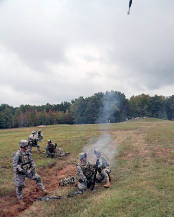 A 60mm mortar system mortar crew with Company D, 2nd Battalion, 506th Infantry Regiment, 4th Brigade Combat Team, 101st Airborne Division, engage a simulated enemy during the walk-and-shoot exercise of Eagle Flight III on Sept. 28, 2012 at Fort Campbell, Ky. (U.S. Army Photo by Staff Sgt. Todd A. Christopherson, 4th Brigade Combat Team Public Affairs)