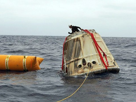 The Dragon spacecraft is secured before being transported back to a SpaceX facility. (SpaceX)
