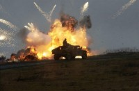 An IED explodes next to a Humvee