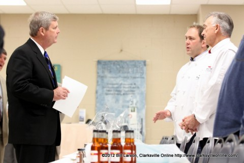 Agriculture Secretary Tom Vilsack visits with Gary and Chad Collier of Papa C Pies