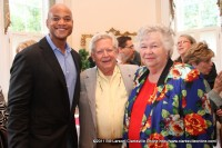 Wes Moore poses for a picture with Mac  and Linda Eddington at the reception in his honor at Archwood