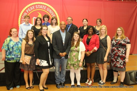 The 2012 Student Essay and Creative Expression contest winners pose for a photograph with author West Moore.