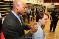 Author Wes Moore signs a young fan's Peay Read shirt