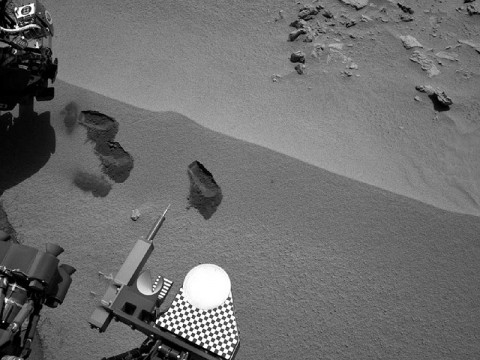 Three bite marks left in the Martian ground by the scoop on the robotic arm of NASA's Mars rover Curiosity are visible in this image taken by the rover's right Navigation Camera during the mission's 69th Martian day, or sol (October 15th, 2012). (Image credit: NASA/JPL-Caltech)