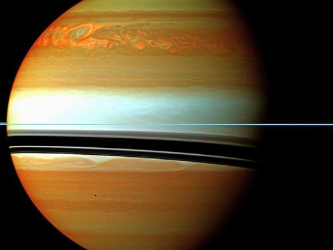 These red, orange and green clouds (false color) in Saturn's northern hemisphere indicate the tail end of a massive storm that started in December 2010. Even after visible signs of the storm started to fade, infrared measurements continued to reveal powerful effects at work in Saturn's stratosphere. (Image credit:NASA/JPL-Caltech/Space Science Institute)